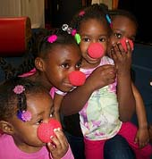 Kids with clown noses at a birthday party