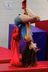 Girl upside down on aerial tissu